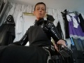 Black PVC shirt and black cotton tie with black PVC skirt under a black cotton full length hairdressing  apron