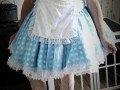 Georgina - dressed in light blue dress with polka dots, white silky apron and tutu petticoat underneathe