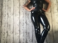 Black latex collar/zip top with blck PVC leggings and boots