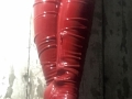 Black latex  leggings with red thigh high boots