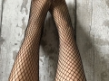 Black fishnet stockings feet