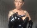 Black, heavily boned, PVC, corset with long PVC gloves