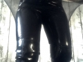 Black, PVC leggings with black, fishnet tights and black PVC thigh length boots